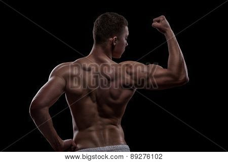 young athlete bodybuilder from back