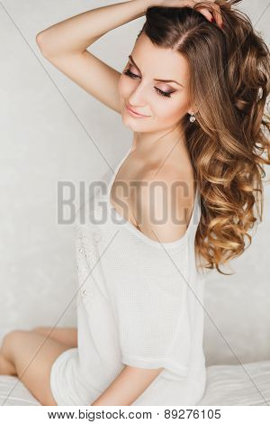 portrait of a beautiful young blond woman with curly long hair