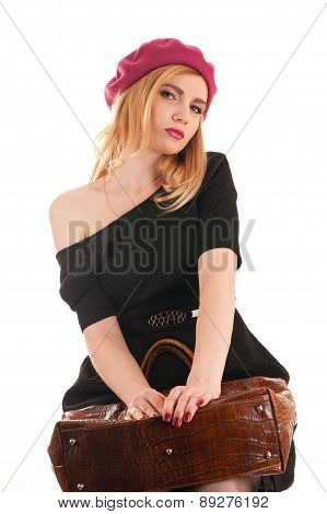 seductive woman sitting waiting with a bag