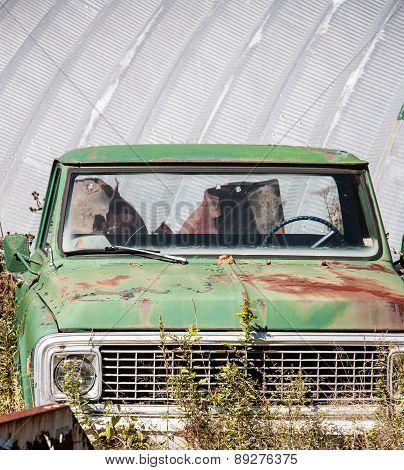 derelict green truck