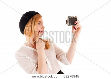 woman take a self on retro camera