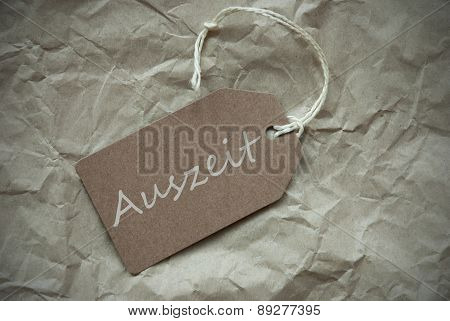 Beige Label With Auszeit Means Downtime Paper