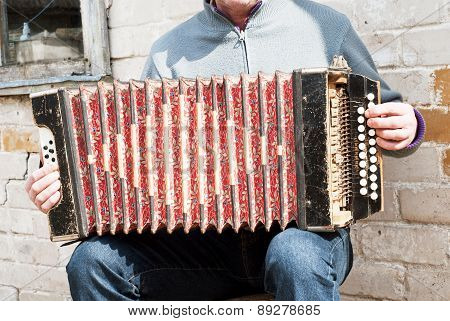 man playing concertina