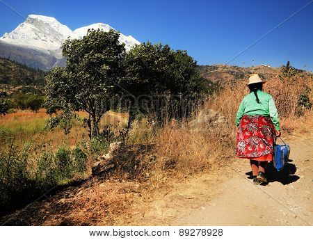 YUNGAY, PERU - AUGUST 23: Peruvian peasant woman returning form the market of Huaraz, Peru South America, August 23 2012