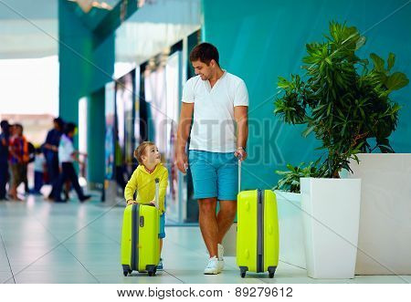 Happy Family With Luggage Ready For Summer Vacation, In Airport
