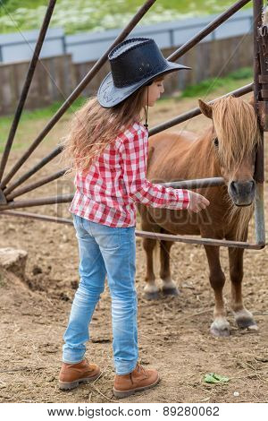 cowboy girl with a pony foal