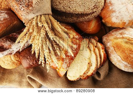 Different bread with ears on sackcloth background