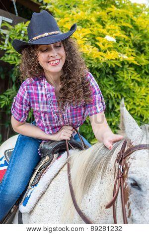cowboy woman on a horse closeup