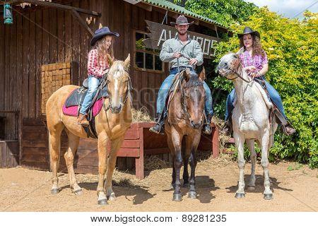 cowboy family of three on horses
