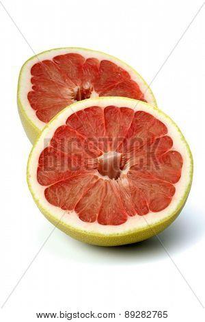 Halved grapefruit on white background