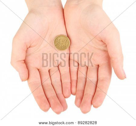 Female hands with coin isolated on white