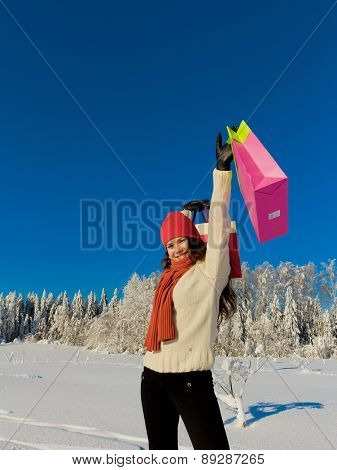 Young Shopping Woman Enjoying the Snow