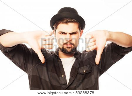 emotional and people concept: young man doing bad signal isolated on white