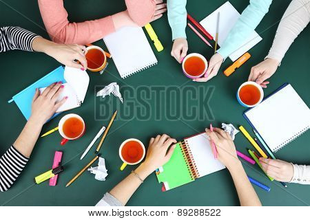 Creative team for work flow on blackboard background top view