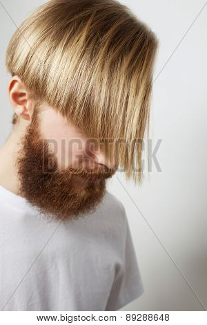 Stylish bearded man in white shirt. Close up portrait over grey background.