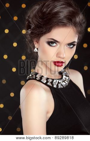 Beautiful Model Brunette With Red Lips And Hairstyle. Fashion Glamour Lady Portrat Over Lights Backg