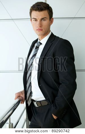 Portrait of businessman with hands in pockets
