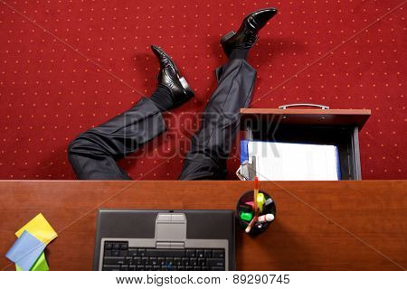 Businessman lying in the office