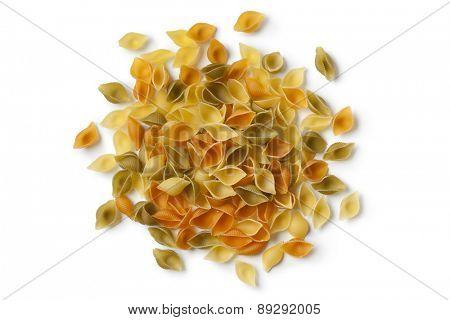 Heap of traditional Italian Conchiglie tricolore on white background