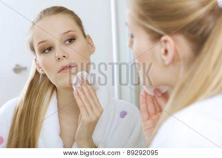 Woman using dabber, portrait, close-up