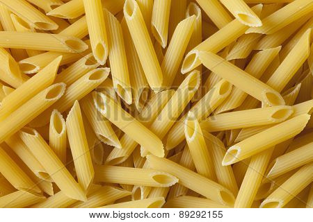 Traditional Italian penne rigate tricocolore close up full frame