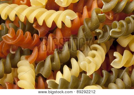 Traditional Italian fusilli tricocolore close up full frame
