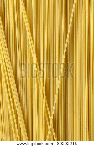 Raw dried traditional Italian spaghetti full frame