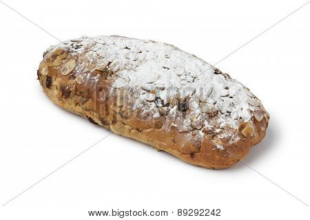 Traditional whole dutch easter bread covered with sugar on white background