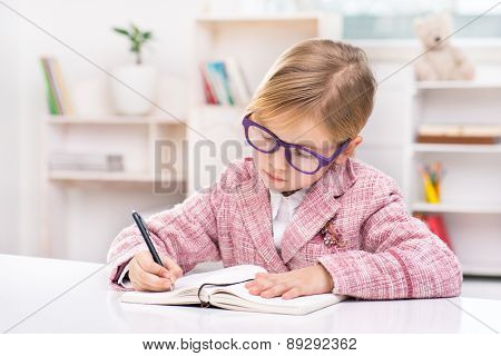 Little cute girl playing role of business woman
