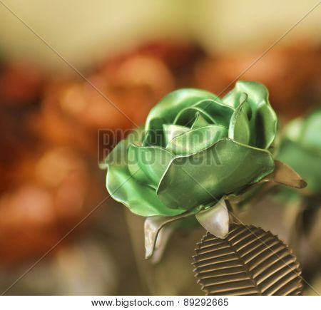 A Green Metal Rose Among Dozens More