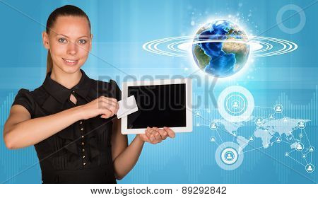 Smiling woman holging tablet and blank card