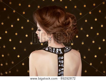 Brown Hair. Beautiful Elegant Woman With Hairstyle. Fashion Girl With Gemstone Jewelry On Back Posin