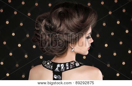 Hairstyle. Brunette Woman With Wavy Retro Hair Styling. Fashion Girl Model Isolated On Black Backgro
