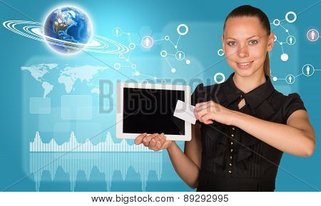 Businesswoman holging tablet and graphical charts