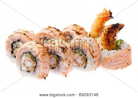 Prawn tempura, cream cheese, cucumber, baked salmon and  masago sauce rolls isolated on white background