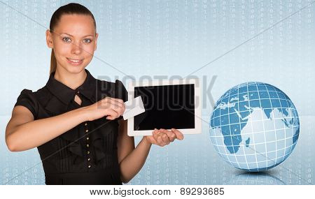 Young woman holging tablet and blank card