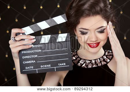 Fashion Elegant Woman Posing With Sexy Red Lips Holding Cinema Clap. Super Star Model Shot. Happy Sm