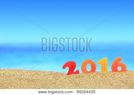 New year number 2016 on the beach