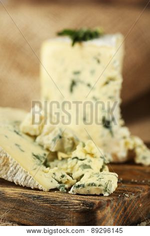 Blue cheese on wooden cutting board. closeup