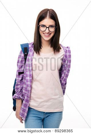 Happy young female student with backpack looking at camera over white background