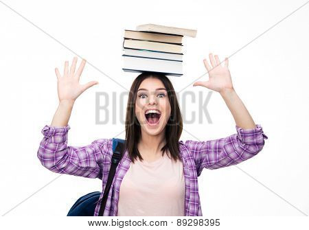 Laughing young wowan with books on head over white background. Looking at camera