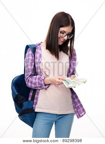 Happy young woman with backpack holding bills of dollar
