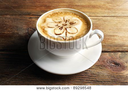 Cup of coffee latte art on wooden background
