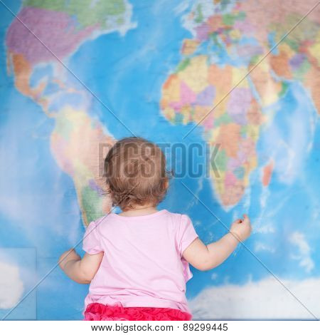 Baby Girl Studying Map Of World
