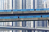 foto of hong kong bridge  - high speed train on bridge in hong kong downtown city at day - JPG