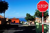 picture of cobblestone  - Stop sign on a cobblestone street controlling next to no traffic on the island of Fogo Cabo Verde - JPG