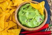 stock photo of chillies  - Guacamole in Wooden Bowl with Tortilla Chips and Chilli