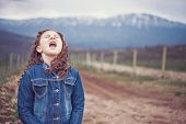 stock photo of yell  - Little girl in nature yelling - JPG