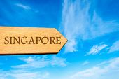 Wooden arrow sign pointing destination SINGAPORE poster