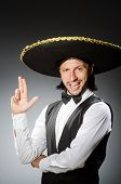 stock photo of sombrero  - Mexican man wears sombrero isolated on white - JPG